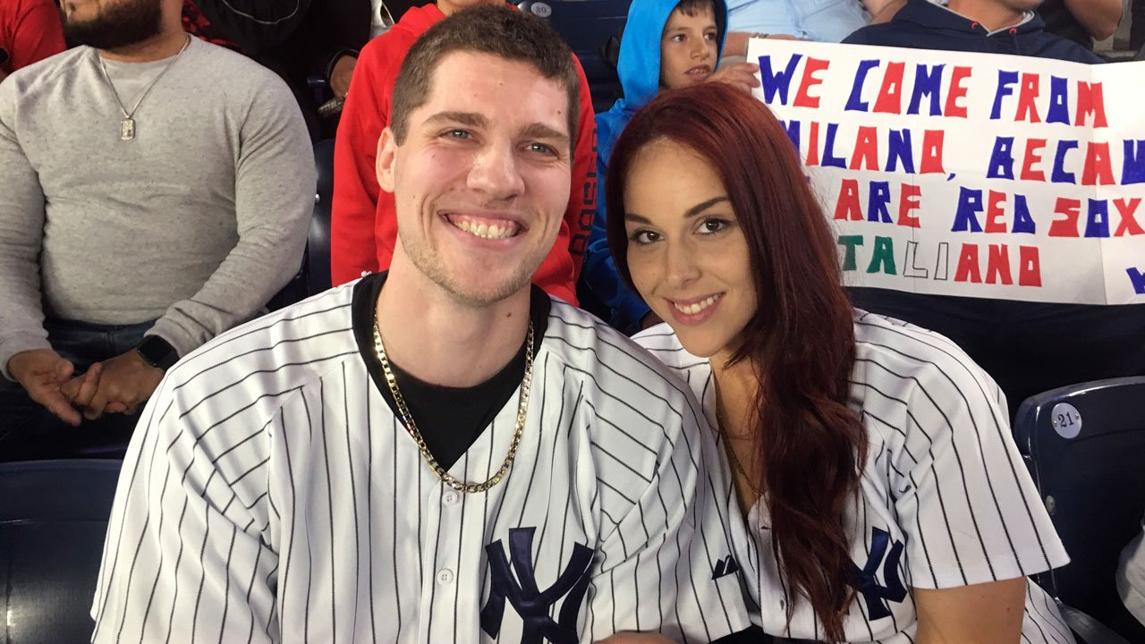 When Andrew Fox pulled a ring from his pocket to propose to Heather Terwilliger during Yankees' game, the ring dropped to the ground. A frantic search ensued until she saw something shiny in the cuff of her pants leg. (Scott Orgera via AP)