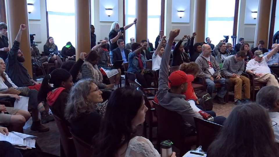 Protesters, many of whom spent the night camping outside of City Hall, filled the council chambers Wednesday as the city council discussed a proposed new contract with the Portland Police Association. (KPTV)