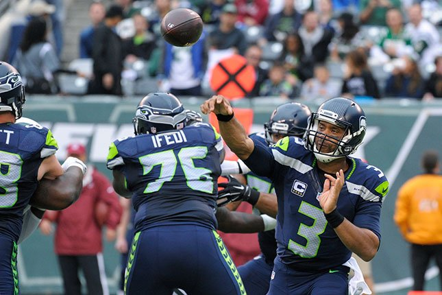 Seattle Seahawks quarterback Russell Wilson (3) throws a pass during the second half of an NFL football game against the New York Jets Sunday, Oct. 2, 2016, in East Rutherford, N.J. (AP Photo/Bill Kostroun)