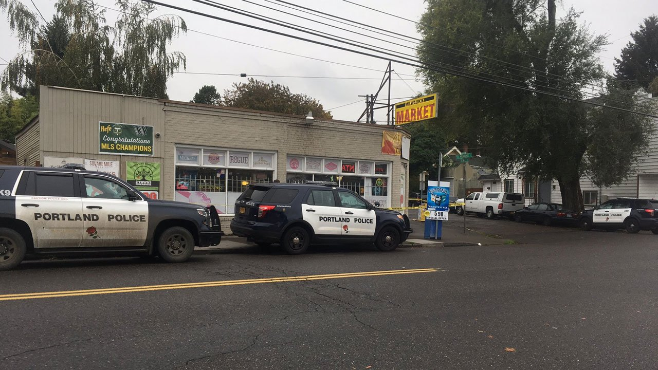 Portland police said two men robbed the Milwaukie Market, pistol-whipping an employee while his 5-year-old hid. (KPTV)