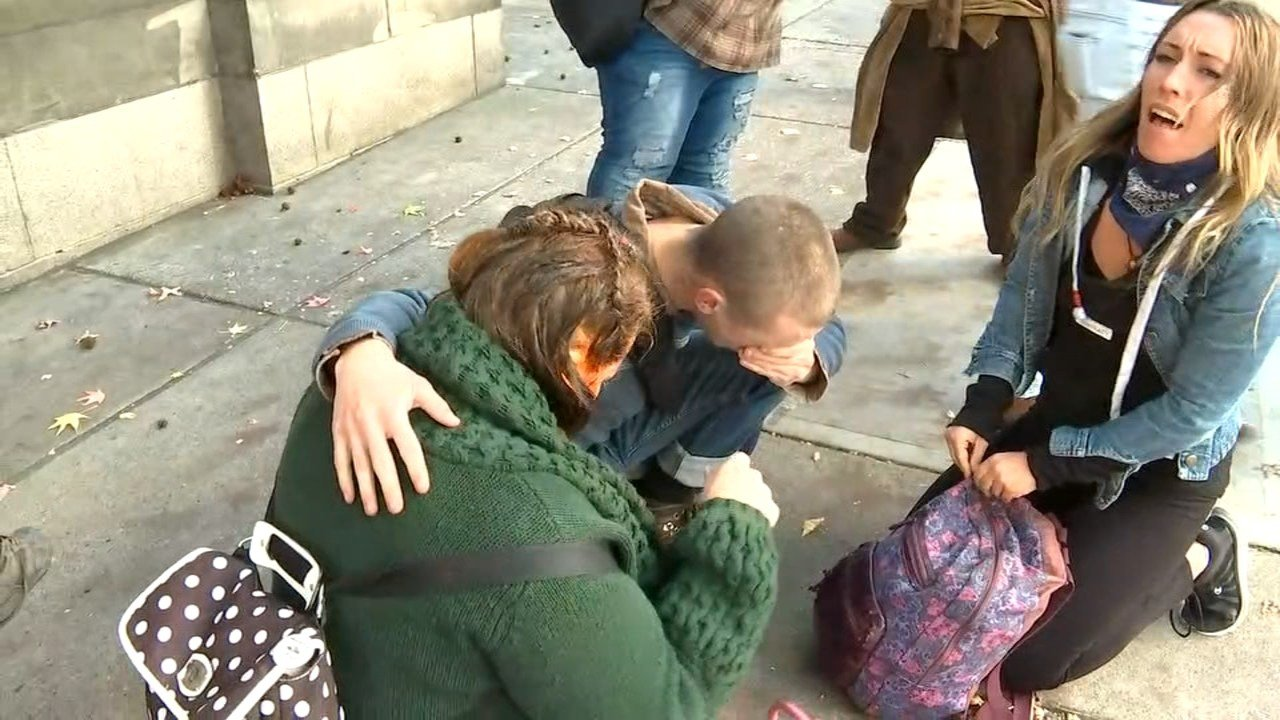 A protester reacting to the use of pepper spray outside City Hall. (KPTV)