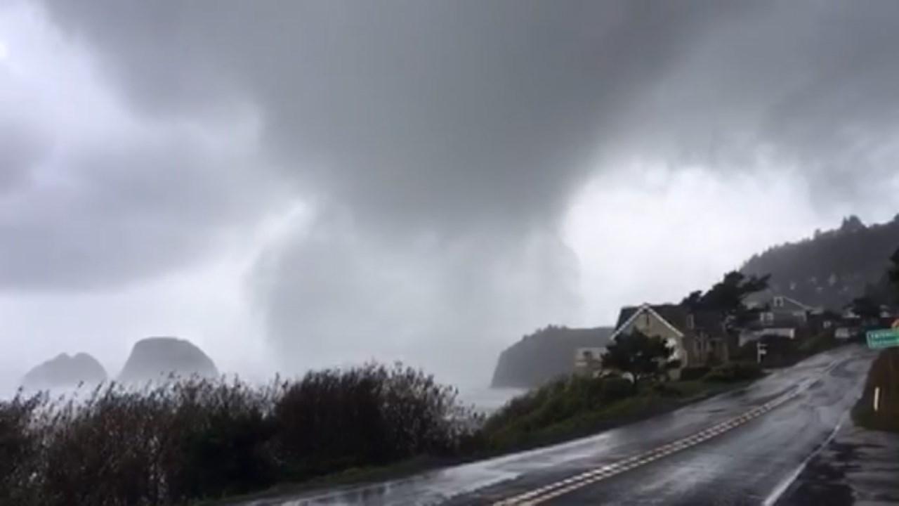 Image of tornado reaching land in Oceanside. (Image courtesy: Saxon Williams)