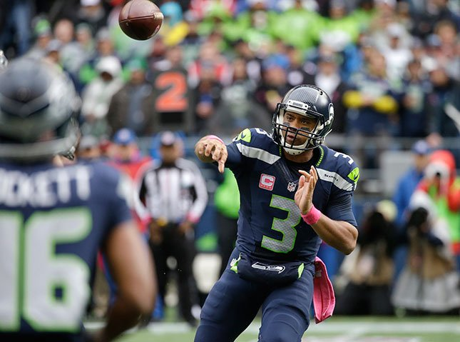 Seattle Seahawks quarterback Russell Wilson passes against the Atlanta Falcons in the first half of an NFL football game, Sunday, Oct. 16, 2016, in Seattle. (AP Photo/Elaine Thompson)