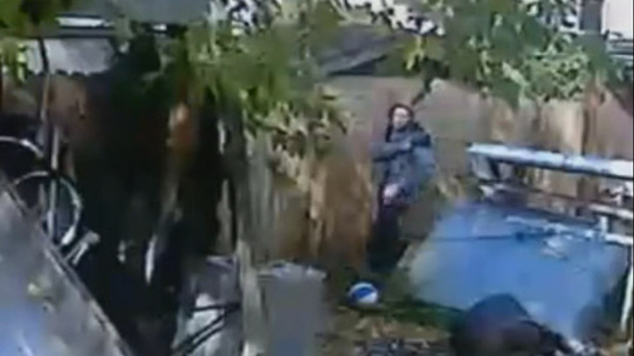 Surveillance image of stranger outside home in southeast Portland. (KPTV)