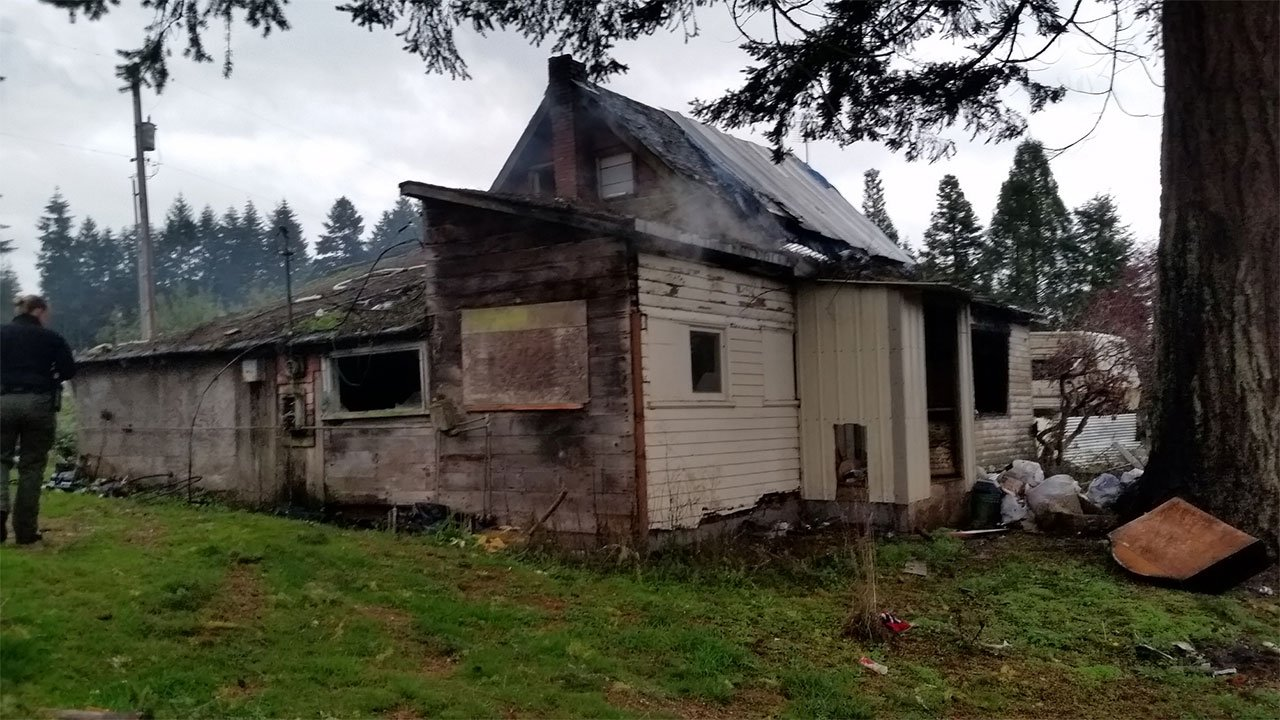 Cowlitz Co. deputies said the a fire at a house on Bunker Hill Road Sunday left the home as a total loss. (Cowlitz Co. Sheriff's Office)