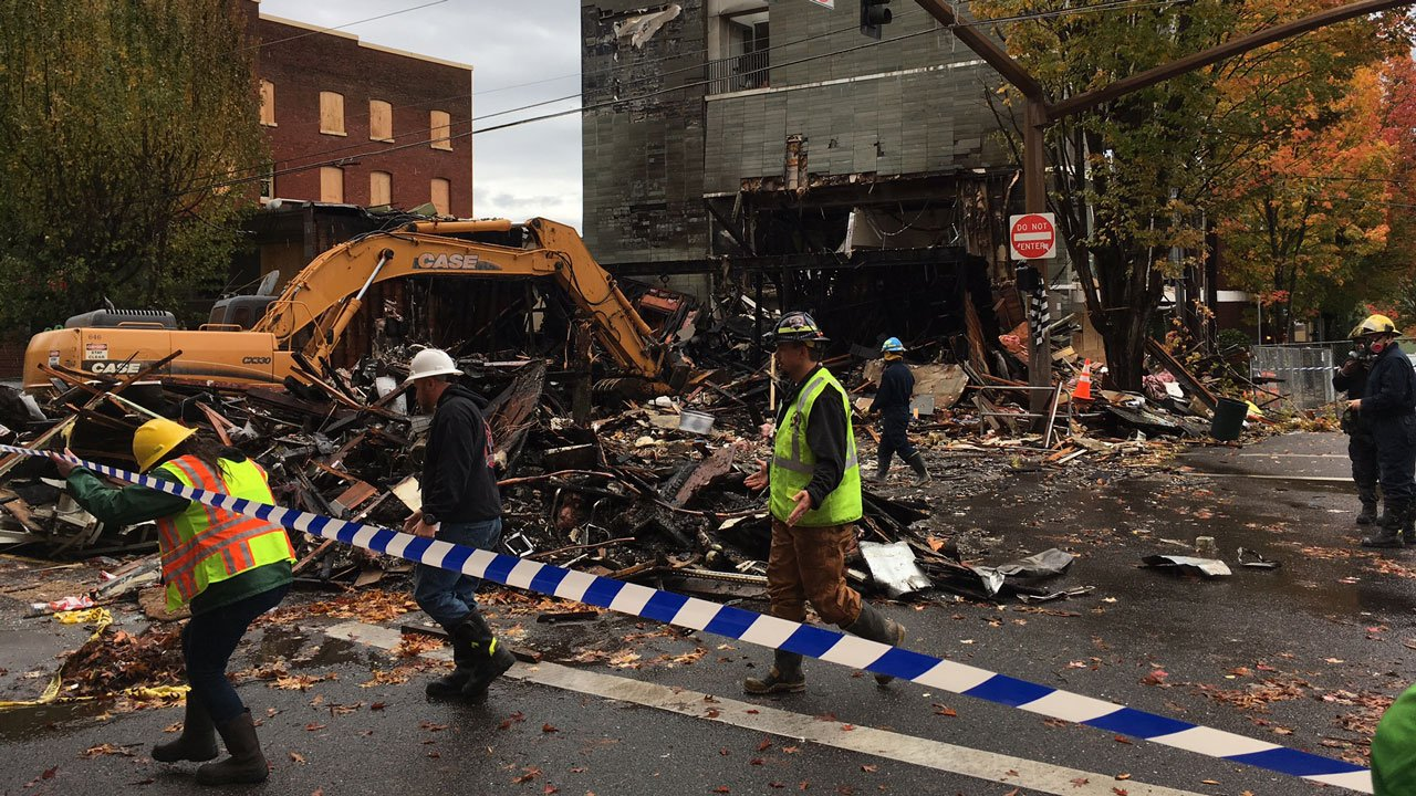 Crews continue to remove debris from the location of a gas explosion in northwest Portland that destroyed the business Portland Bagel Works, among others. (KPTV)