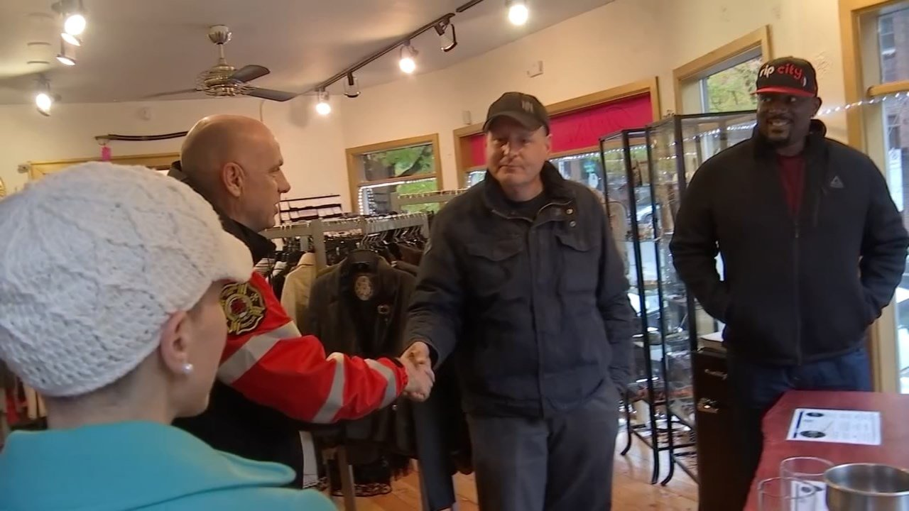 Fire Chief Mike Myers meeting business owners along NW 23rd on Thursday. (KPTV)