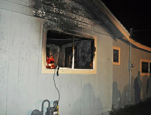 This photo provided by the Spokane, Wash., Fire Department shows the exterior of a home where a toddler and his dog died in a fire, seen Saturday, Oct. 22, 2016. (Spokane Fire Department via AP)