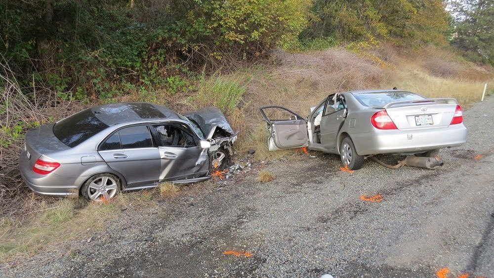 A Mercedes that sped away from a OSP traffic stop after a woman fled from the car went the wrong way down an off ramp onto Interstate 5 before hitting another vehicle head-on a few miles down the interstate. (Oregon State Police)