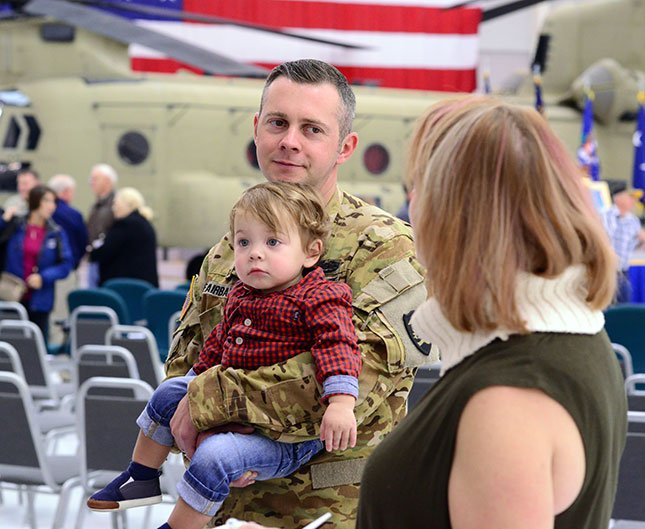 Staff Sgt. Matthew Fairbank with 1st Battalion, 168th Aviation, holds his 1-year-old son, Anson, following his demobilization ceremony on Oct. 22, 2016, in Pendleton. (Photo: Sgt. 1st Class April Davis)