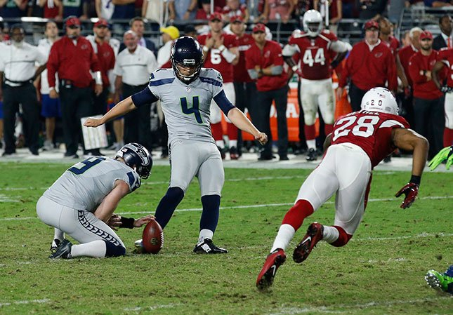 Seattle Seahawks kicker Stephen Hauschka (4) kicks a field goal as punter Jon Ryan (9) holds during the second half of a football game against the Arizona Cardinals, Sunday, Oct. 23, 2016, in Glendale, Ariz. (AP Photo/Ross D. Franklin)