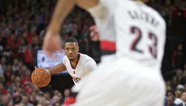 Portland Trail Blazers guard Damian Lillard brings the ball up court against the Utah Jazz during the first half of an NBA basketball game in Portland, Oct. 25. (AP Photo/Craig Mitchelldyer)