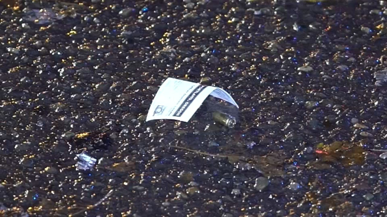 Evidence marker of bullet outside 7-Eleven store that was robbed in southeast Portland. (KPTV)
