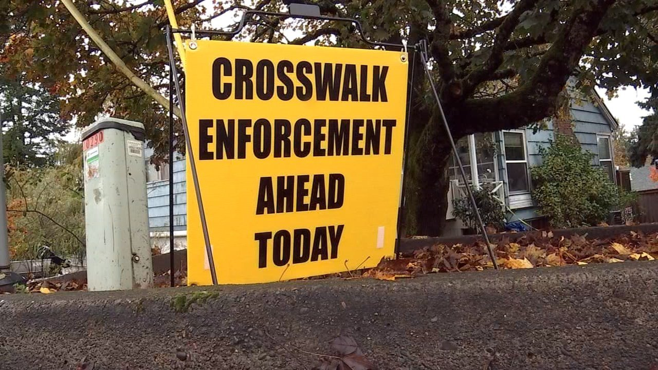 Portland police were monitoring crosswalks near SW 40th Ave. and SW Huber St. in an attempt to get drivers to slow down ahead of expected crowds of trick-or-treaters Monday. (KPTV)