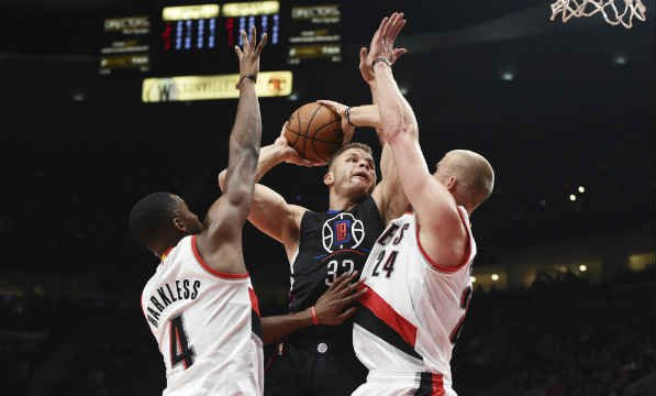 Los Angeles Clippers forward Blake Griffin drives to the basket against Portland Trail Blazers forward Maurice Harkless and forward Mason Plumlee during the first quarter of an NBA basketball game in Portland Oct. 27. (AP Photo/Steve Dykes)