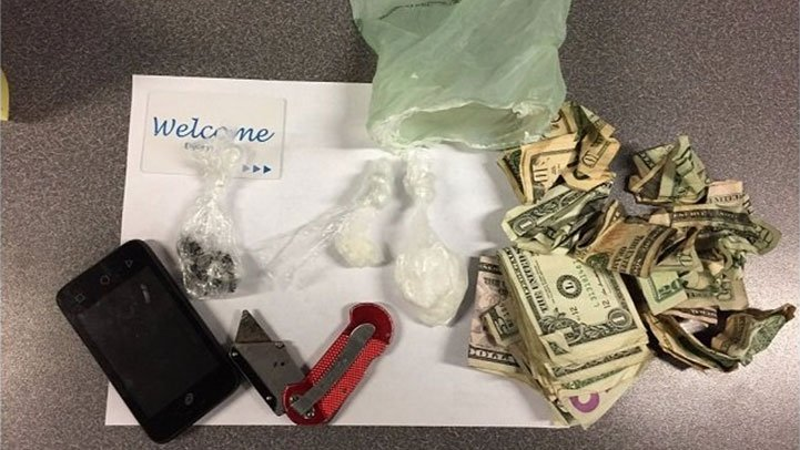 Police seized heroin, cocaine, $300 in cash and a knife during an arrest in Old Town Tuesday night. (Portland Police Bureau)