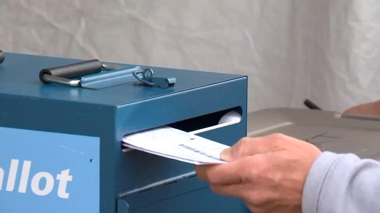 Voters were turning in their ballots are multiple drop sites like this one in Washington County Monday, a day before all ballots were due. (KPTV)