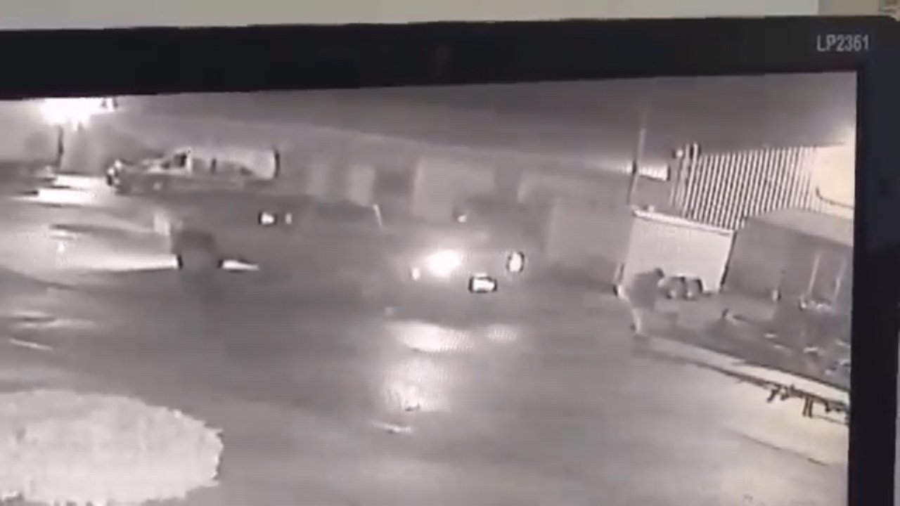 Surveillance video of the suspect dragging the wood mill to his truck.