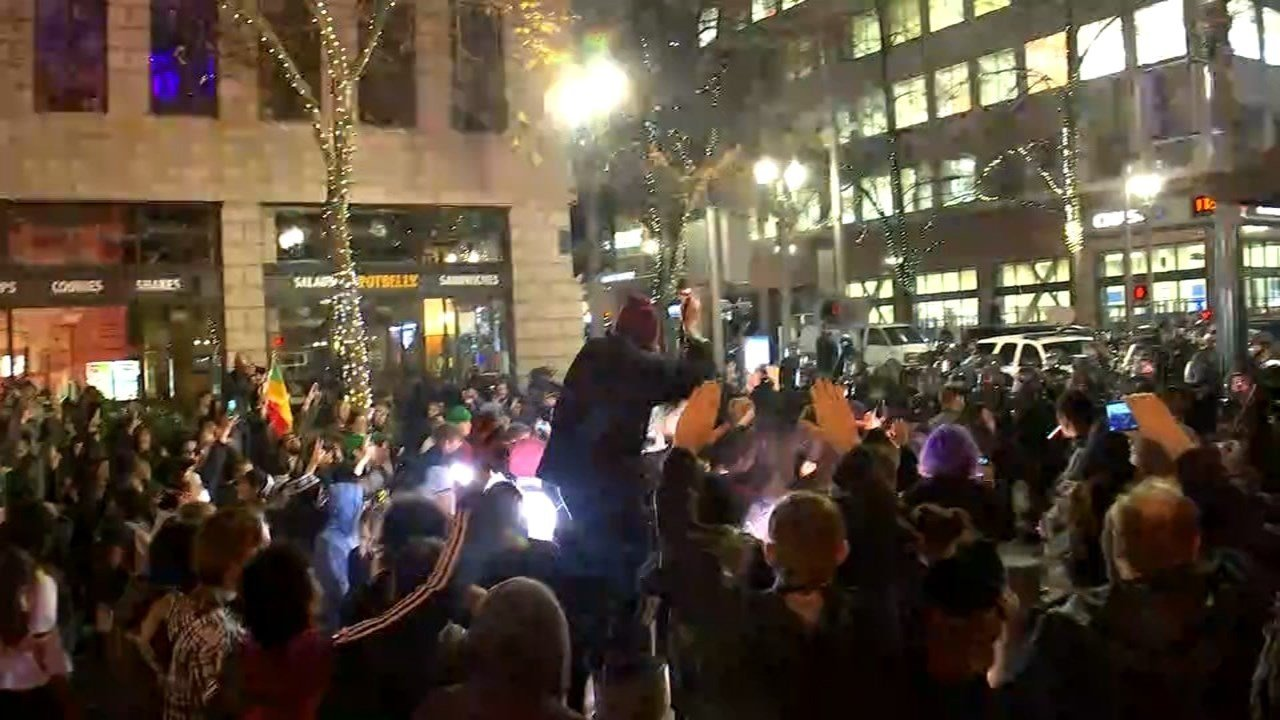 Portland police said a protest that began with several thousand people marching through downtown Thursday night turned into a riot as anarchists in the crowed began breaking windows of cars and buildings.