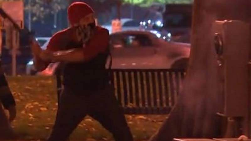 Police said this photo shows Mateen Shaheed causing damage during a riot in Portland in November 2016. (Image: Portland Police Bureau)
