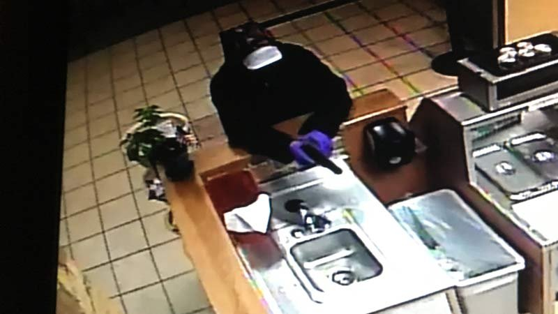 Surveillance image of Corvallis Subway robbery suspect released by Corvallis Police Department.