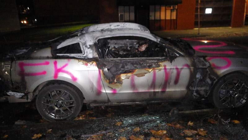 A car was spray-painted with anti-Donald Trump graffiti and set on fire in southeast Portland. (Photo: Portland Police Bureau)