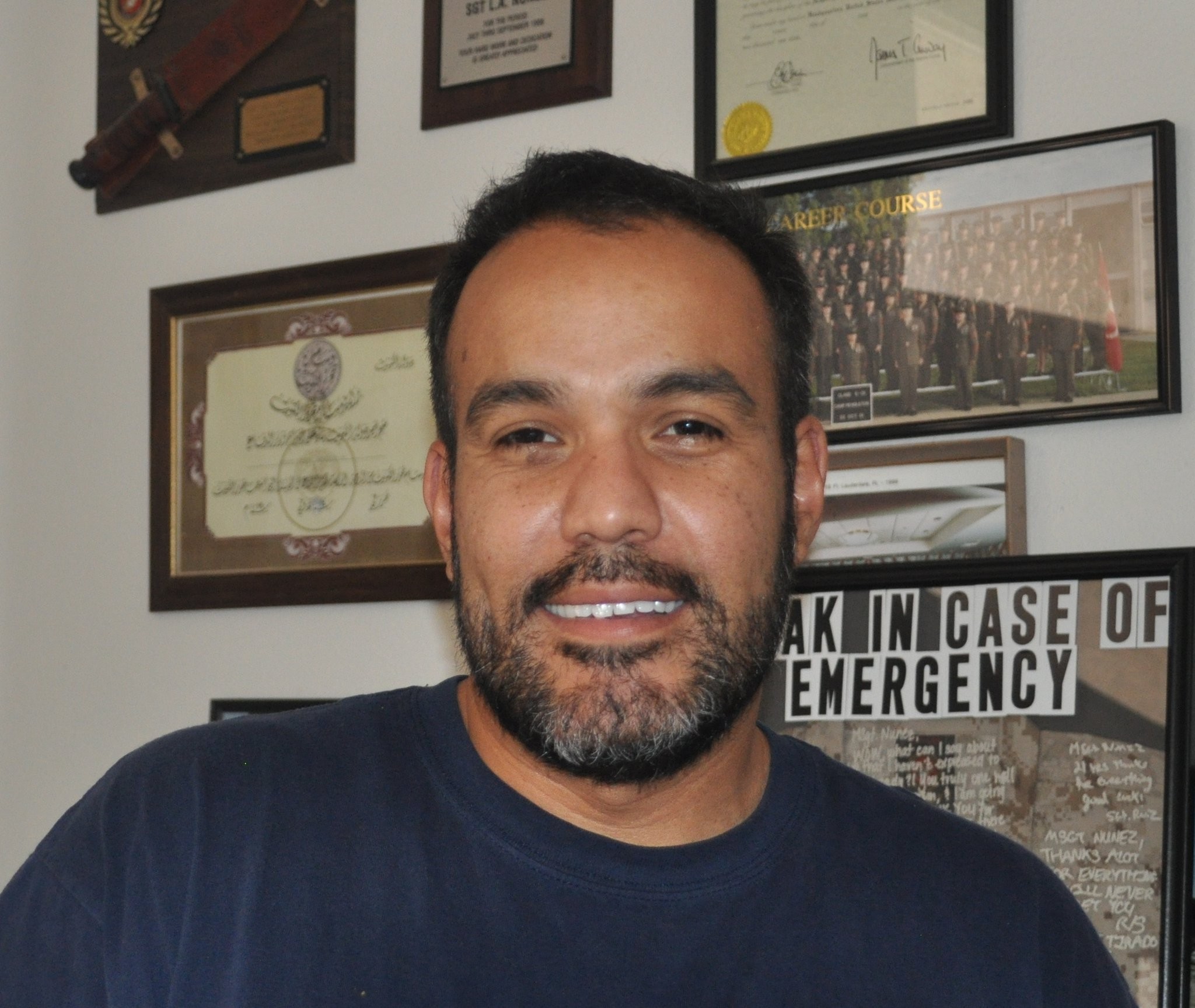 Nunez with some of his awards in the background.
