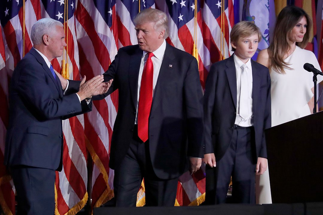 President-elect Donald Trump, joined by his son Baron, second from right, and wife Melania, greets Vice-President-elect Mike Pence as he arrives on stage during his election night rally, Wednesday, Nov. 9, 2016, in New York. (AP Photo/Mary Altaffer)