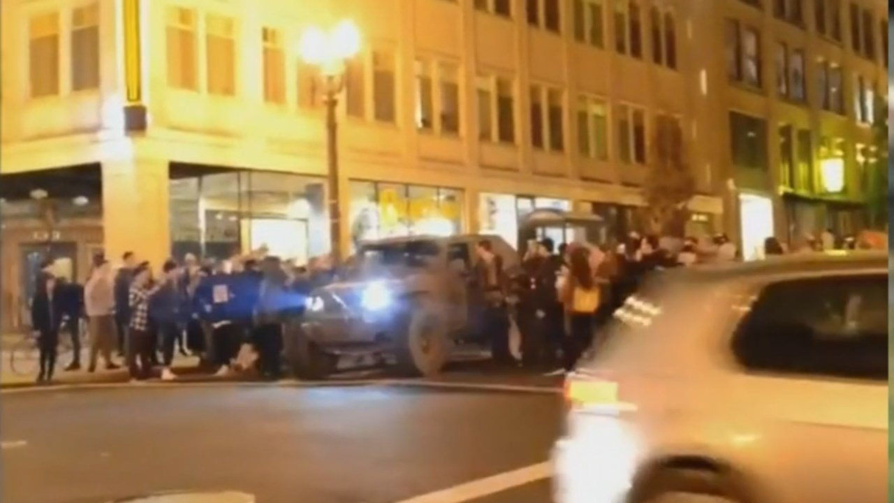 Gresham resident Valentin Muntyan said protesters ripped American flags from his Jeep before smashing his headlight and windshield during ant-Trump demonstrations in Portland. (KPTV)