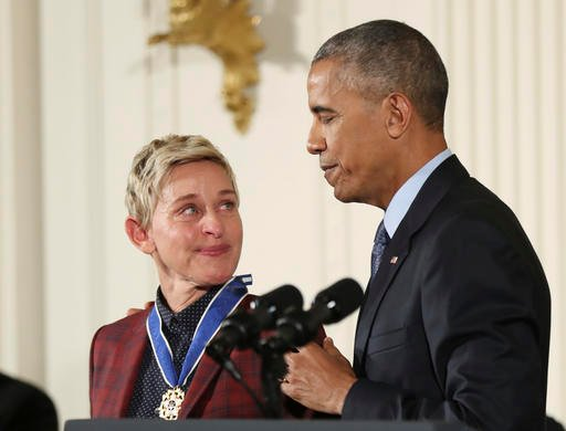 (AP Photo/Manuel Balce Ceneta). Actress, comedian, and talk show host Ellen DeGeneres, glances at President Barack Obama as she is presented the Presidential Medal of Freedom during a ceremony in the East Room of the White House Tuesday, Nov. 22, 2016.
