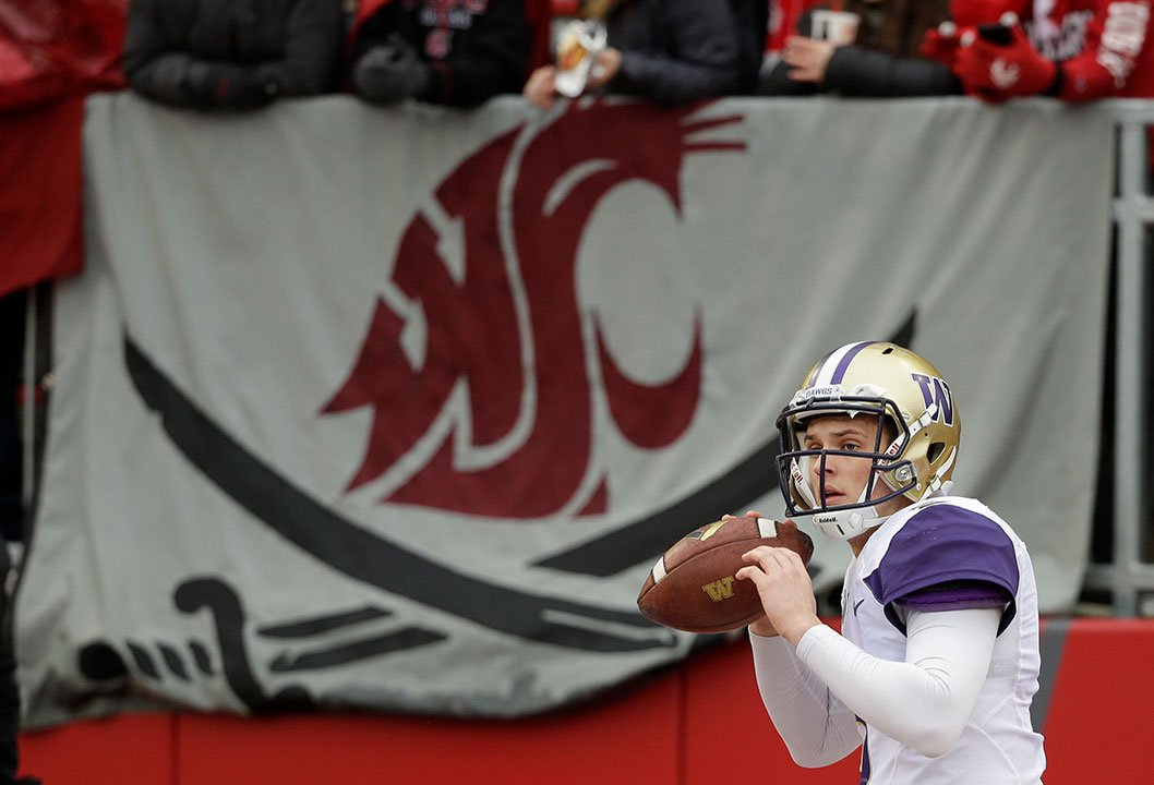 Washington quarterback Jake Browning warms up before an NCAA college football game against Washington State, Friday, Nov. 25, 2016, in Pullman, Wash. (AP Photo/Ted S. Warren)