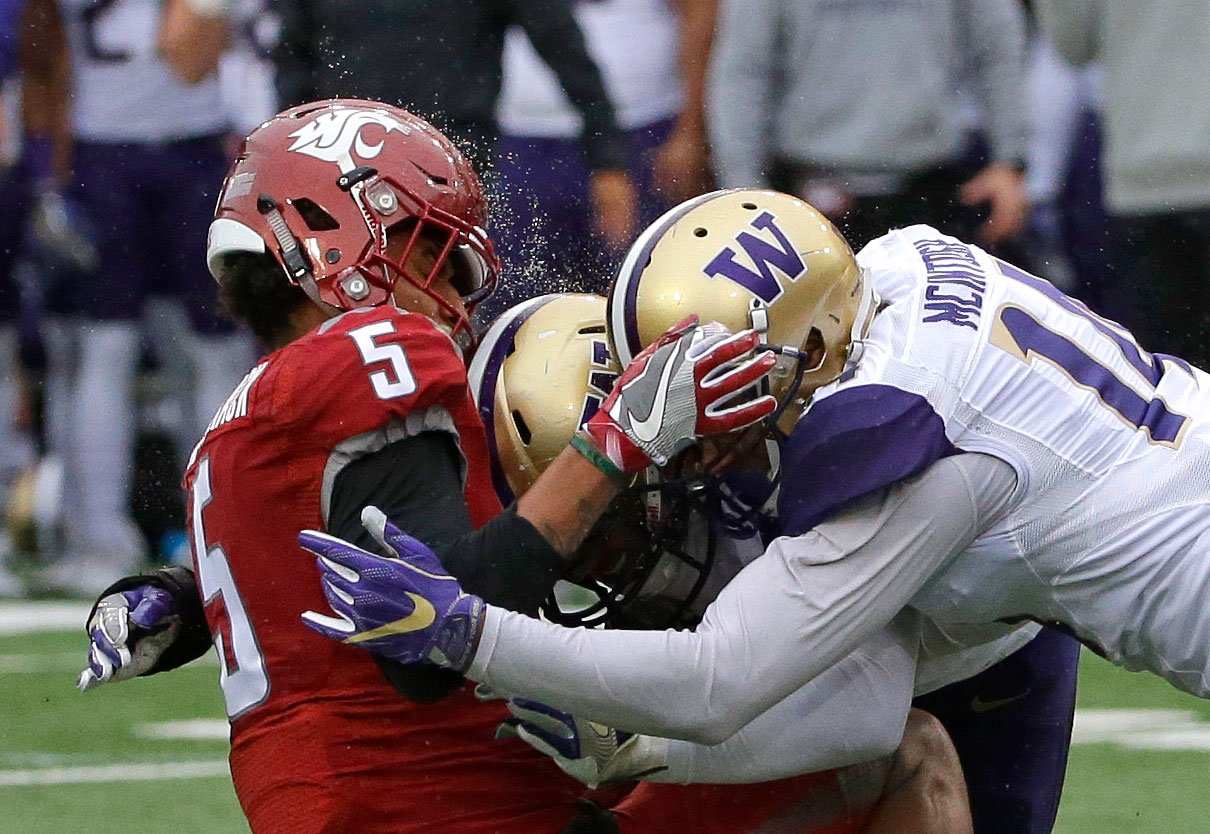 Washington State WR Isaiah Johnson-Mack is hit by Washington LB DJ Beavers and DB Jojo McIntosh on an incomplete pass play in the first half of the Apple Cup game Friday, Nov. 25, 2016, in Pullman, Wash. (AP Photo/Ted S. Warren)