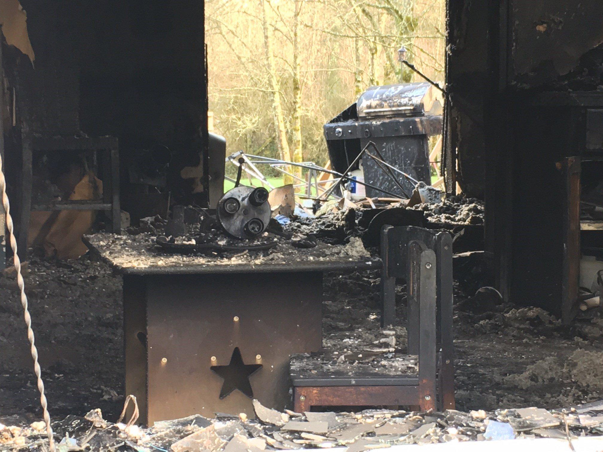 The charred debris viewed through a front window.  (KPTV)