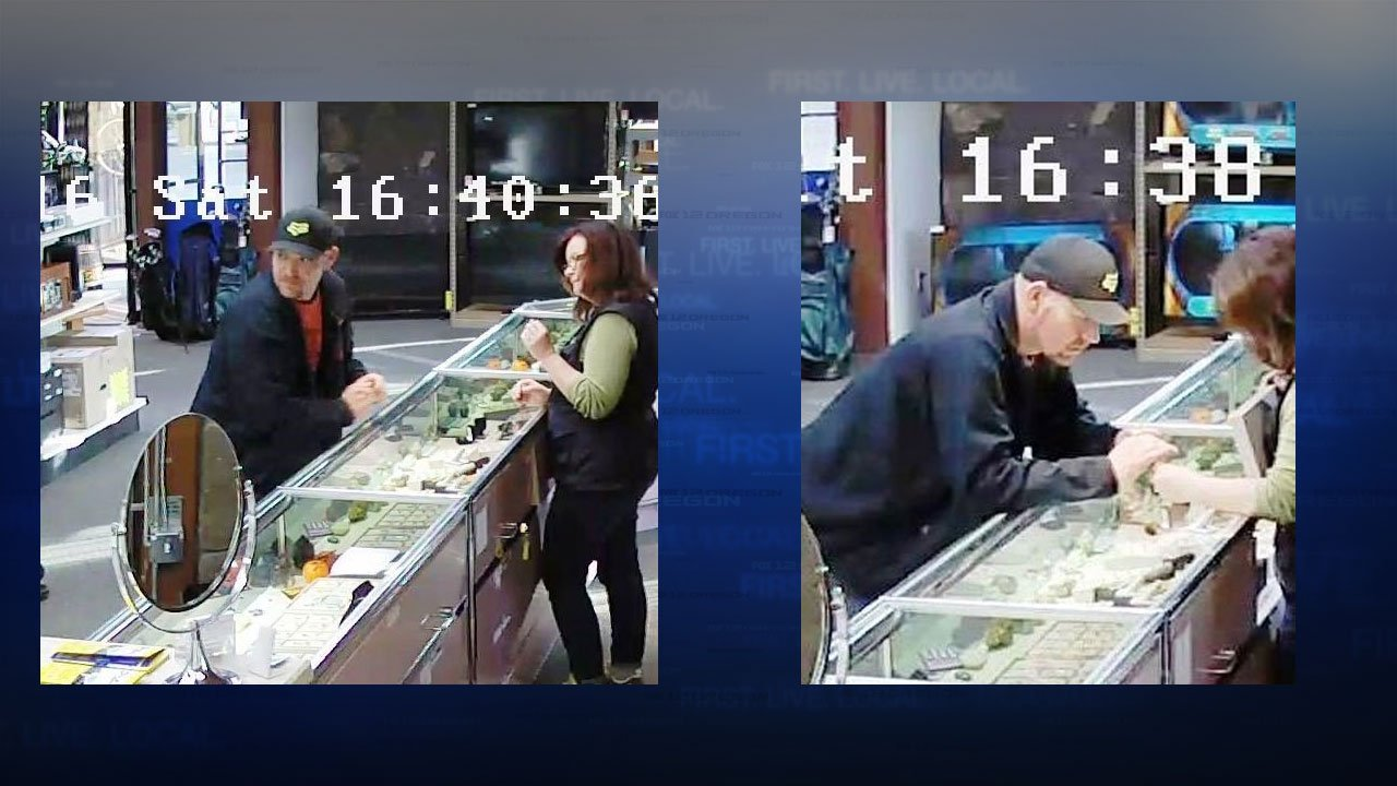 Surveillance video shows the suspect in the robbery of a Gresham pawn shop moments before he runs from the store after an employee gives him two rings he asked to see. (Gresham Police Dept.)