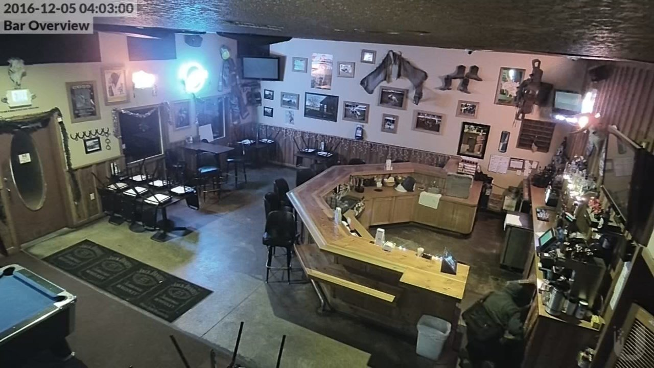 The burglar can be seen in the lower right hand corner rummaging through the bar. (Courtesy: Marion County Sheriff's Office)