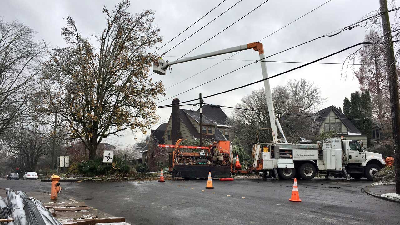 A PGE crew works on power lines in NE Portland
