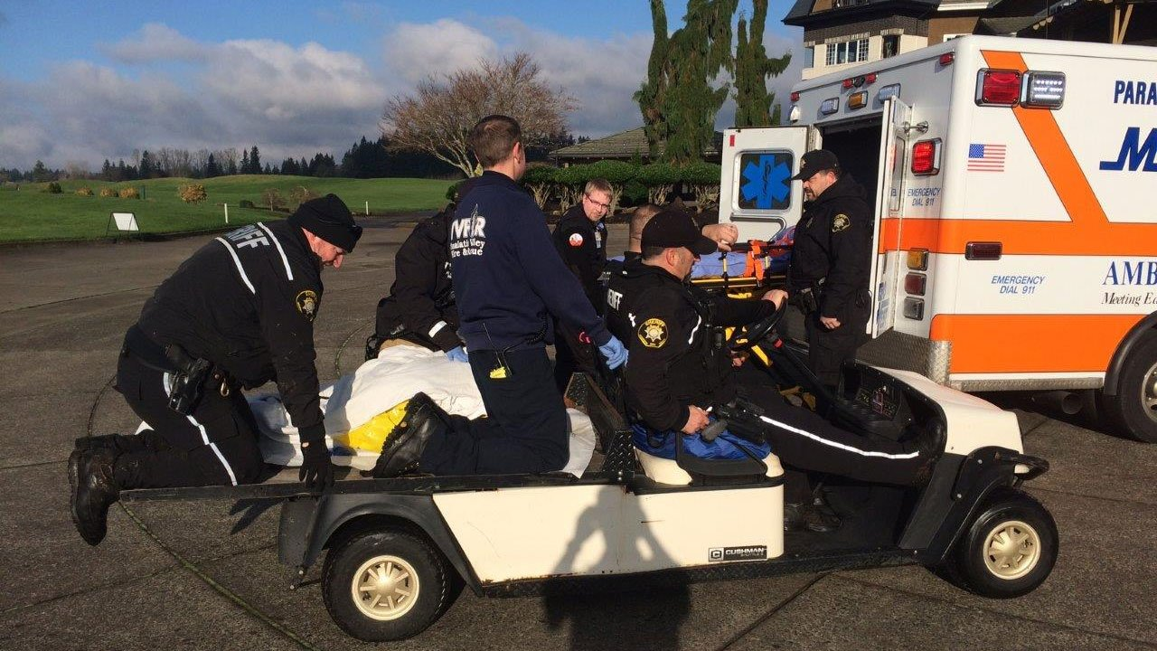 Deputies were assisted by rescue crews from Tualatin Valley Fire and Rescue to get treatment for a man experiencing hypothermia after running through a creek trying to flee from a traffic stop Tuesday. (Washington Co. Sheriff's Office)