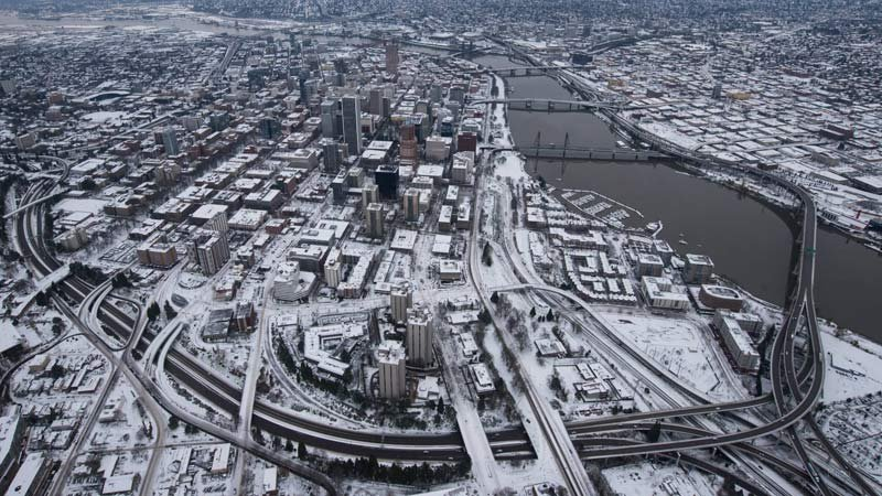 Air 12 flew over snow-covered Portland on Thursday. (KPTV)