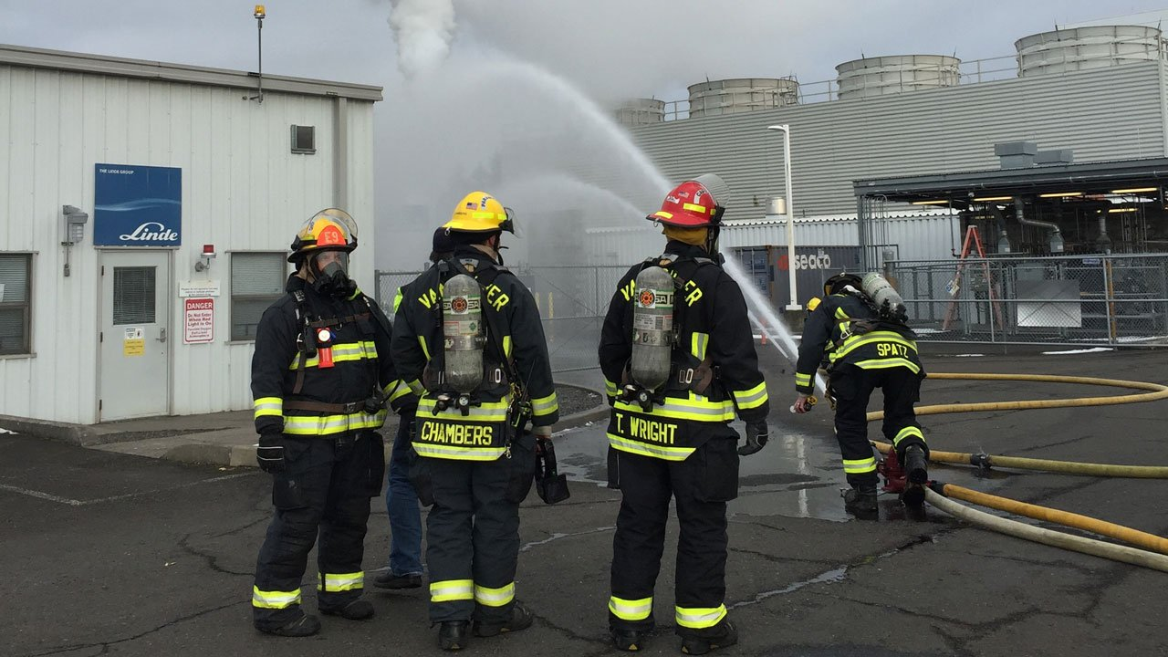Crews from the Camas-Washougal Fire Department worked to keep a 3,000-gallon hydrogen tank cool as other worked to put out a nearby fire Saturday afternoon. (Camas-Washougal Fire Department)