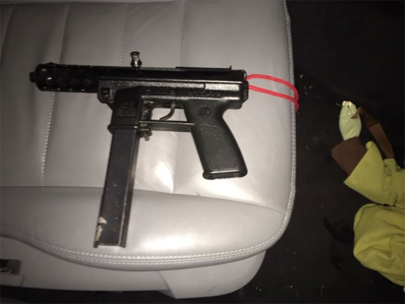 Officers with the PPB's Gang Enforcement Team recovered a Tec-9 handgun with a 32-round magazine during a traffic stop last week.(Portland Police Bureau)