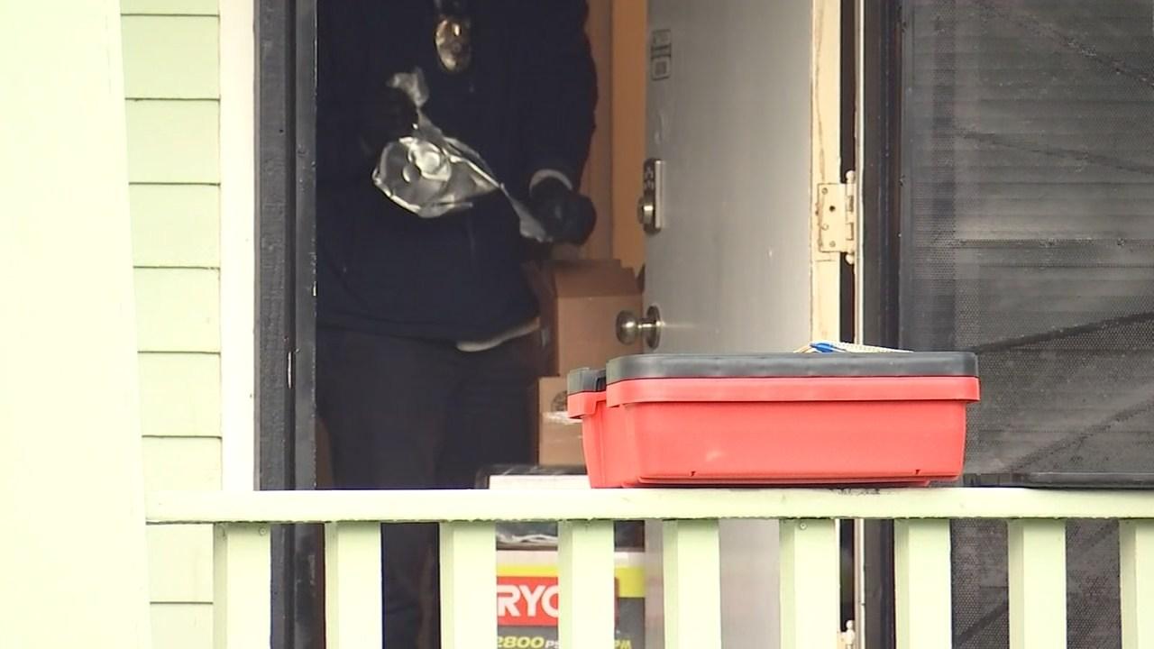 Police investigating at scene of SWAT standoff Wednesday. (KPTV)