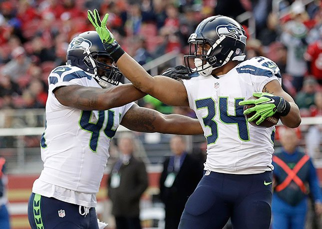 Seahawks running back Thomas Rawls (34) celebrates with fullback Marcel Reece (44) after scoring a touchdown during the first half of an NFL football game against the San Francisco 49ers in Santa Clara, Calif., Jan. 1, 2017. (AP Photo/Marcio Jose Sanchez)