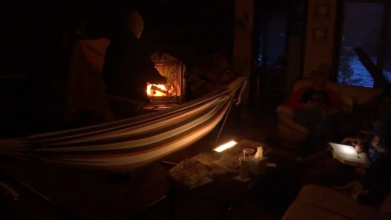 The Stanton family gathered near the fireplace after being left without power for several hours. (KPTV)
