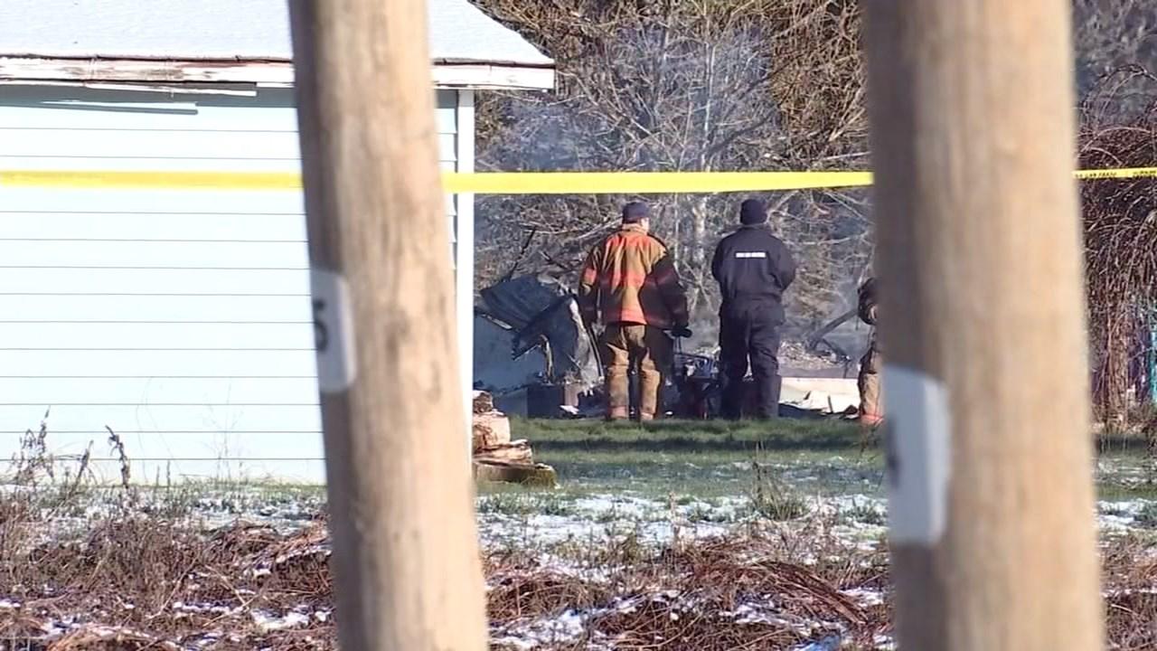Investigators at the scene in Hubbard where five bodies were found in a burned home. (KPTV)