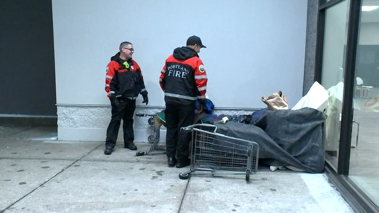 Portland firefighters checking on a homeless person during the snowstorm. (KPTV file image)