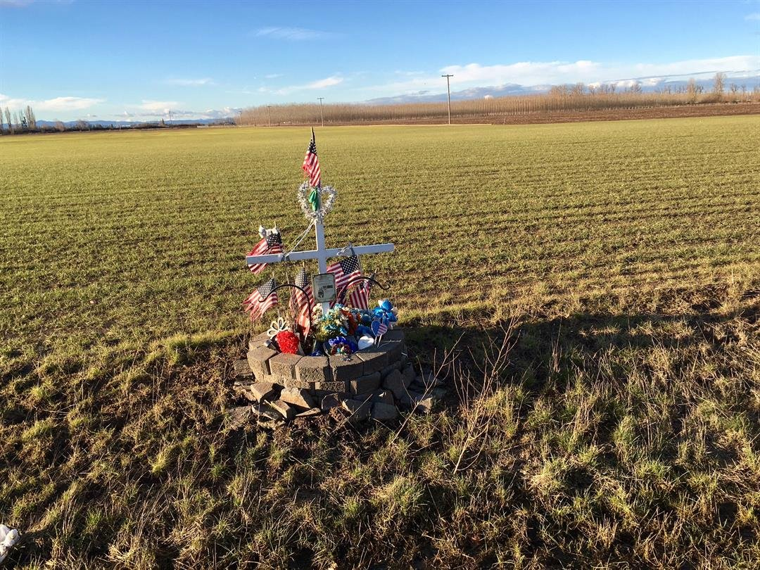 The memorial still at the crash site on Highway 99E near Gervais. (KPTV, January 2017)