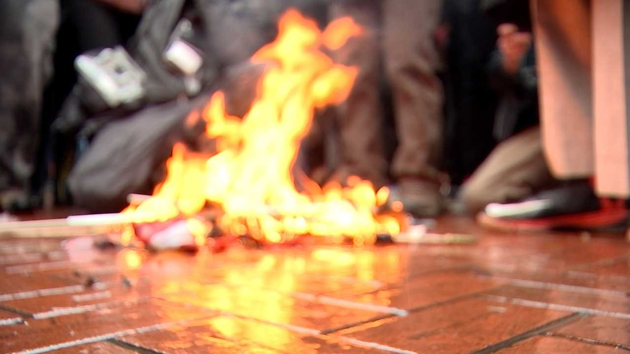Multiple demonstrators gathered in Pioneer Courthouse Square on January 20 to burn American flags as part of a larger protest marking the inauguration of President Donald Trump. (KPTV)