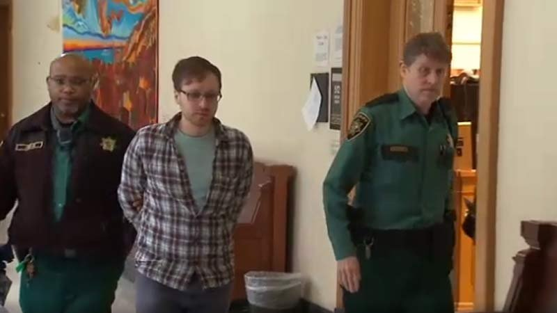 Benjamin Thomas Collura being escorted from the courtroom Wednesday. (KPTV)