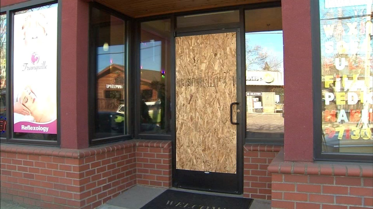 The front door was smashed during a burglary at Tranquille Foot Salon on Southeast Division Street. (KPTV)