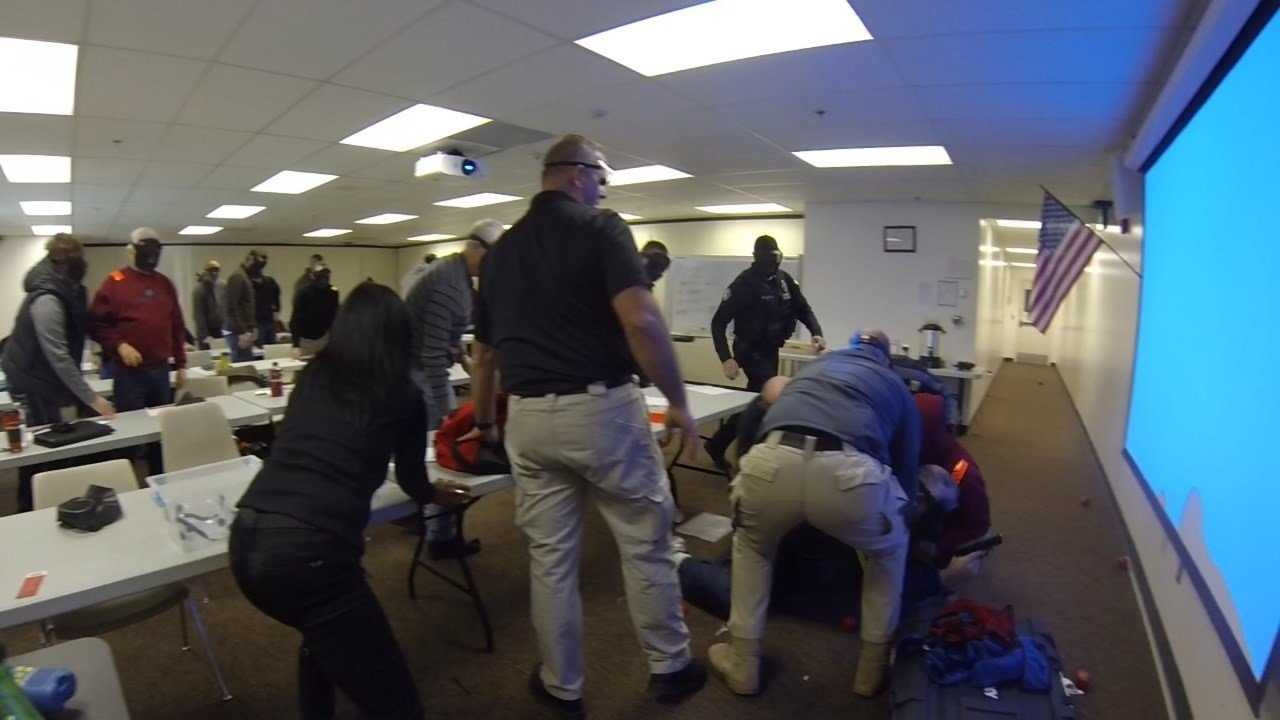 Group of people participating in an active shooter scenario at ALICE Training Institute. (KPTV)